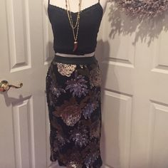 """Amazing black skirt w sequin flowers Oh how I love this skirt but it just doesn't fit me right.  Purchased at Nordstrom, it's great quality and has a """"leather"""" waistband, gold and gunmetal gray sequins, full lining, and side zip. 26 inches long. Adorable with black booties! Joa Skirts"""