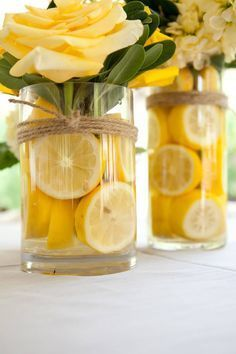 These DIY centerpieces are all sunshine, with buttercup yellow roses and a zing of lemon. Twine wrapped around the vases adds a bit of rustic charm. diy centerpieces simple 25 Stunningly Fresh Wedding Centerpieces With Fruit Summer Table Decorations, Yellow Party Decorations, Summer House Decor, Graduation Table Decorations, Home Wedding Decorations, Reception Decorations, Birthday Decorations, Fruit Centerpieces, Yellow Flower Centerpieces