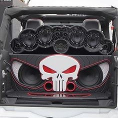 Audison system in a Jeep Wrangler car audio custom install stereo. trunk walled off. skull face. fiberglass eyes