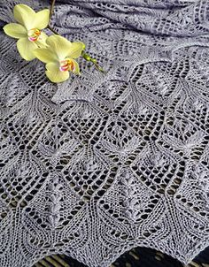 The Flowerbed Stole features a distinctive lace pattern with nupps and double nupps. The stole can be knitted up in variety of yarns from cobweb to light fingering weight.