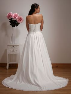 1511 - A stunning chiffon ball gown with ruched bodice and lace appliqué detail. The off the shoulder lace jacket is fully detachable offering two different looks