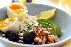 avocado bowl with soft-boiled egg, walnuts, feta cheese and olives Soft Boiled Eggs, Breakfast Tea, Olives, Feta, Avocado, Bread, Cheese, Ethnic Recipes, Breads