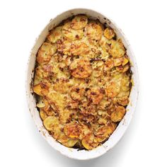 Layer-and-bake dishes offer ways to turn leftovers into something luscious -- and they're ideal mediums for healthful ingredients. In this dish, a little Gruyere cheese provides a decadent texture, while sweet potatoes, leeks, and tangy grated apple make the dish especially moist, so you can use less fat.