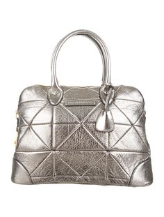 Metallic quilted distressed leather Marc Jacobs tote with gold-tone hardware, dual rolled top handles, logo at front, taupe woven lining, zip closure pocket at interior wall and zip closure at top. Includes dust bag. Shop Marc Jacobs new and pre-owned luxury handbags at The RealReal.