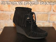 Minnetonka Lace Up Fringe Ankle Boot in Black