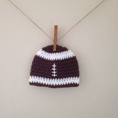A personal favorite from my Etsy shop https://www.etsy.com/listing/246688490/football-beanie-multiple-color-options
