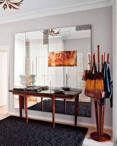 love that entry table. and huge mirror.