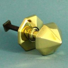 A very elegant solid brass octagonal door centre pull. Cleaned and polished and ready to fit. Comes complete with replacement fixing stud, suitable for doors up to 6.5 cm thick.