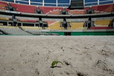 Olympic venues in Rio de Janeiro are falling apart - Sand covers the Olympic venue for tennis at the Olympic Park. This photo was taken Feb. 17.