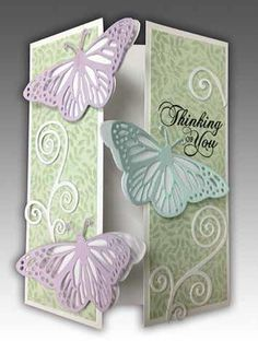 gatefold with flourishes and layered butterflies