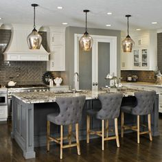 The kitchen has a fresh take on traditional style – timeless, yet updated with sleek freshness.