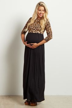 Amp up your winter wardrobe with this fierce animal printed top maternity maxi dress! From casual day to a night out, this comfortable and flattering piece will be your new go-to in every trimester and throughout motherhood!