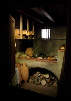 Reconstruction of a taberna. A taberna  was a single room shop covered by a barrel vault within great indoor markets of ancient Rome. Each taberna had a window above it to let light into a wooden attic for storage, and had a wide doorway.