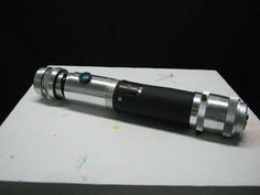 Lightsaber made from a broken camera lens, plumbing pipe, & other odds & ends. Amazing! Instructable at link.