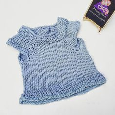 This adorable baby blue, hand knitted, cotton tee is ready to ship. It's a perfect year round baby item, works well in these warm summer months, but teams so nicely too with a long sleeve top for the cooler weather. These are versatile and cute!