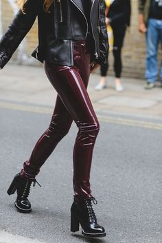 Burgundy patent vinyl pants paired with black leather jacket and lace-up boots with chunky heel. . DIY the look yourself: http://mjtrends.com/pins.php?name=burgundy-patent-vinyl-for-pants