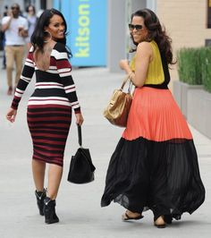 On the left that's Evelyn Lozada from Basketball Wives. She's wearing a FELICITY & COCO Stripe Jersey and Giuseppe Zanotti Hidden Wedge Sneakers. #Swag #NBD
