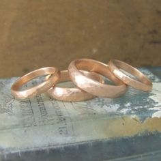 Wedding bands in beaten solid rose gold handmade and unique
