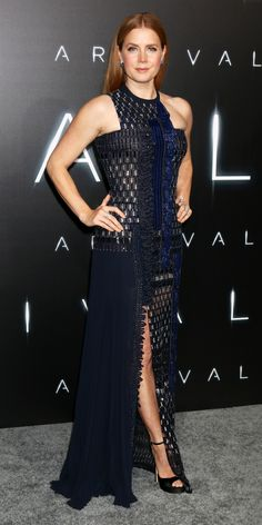 Amy Adams made quite an entrance at the Arrival premiere in a custom navy embellished Atelier Versace creation with geometric beading, an asymmetric neckline, and a thigh-high slit. Sapphire blue studs and patent platforms completed her look.
