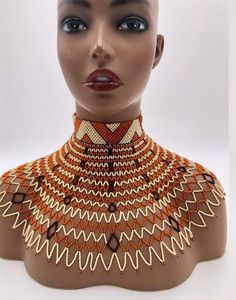 Single Strips of Ankara Laced together to create this masterpiece. Button closure can be worn in front back or side. African Necklace, African Jewelry, Beaded Choker, Beaded Jewelry, Jewellery, Xhosa Attire, Shoulder Necklace, African Traditional Dresses, Unique Bracelets