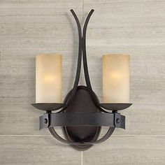 Rustic and chic, this bronze finish wall sconce features gorgeous scavo glass and an elegant design.