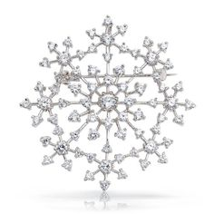 $59.99 This alluring snowflake brooch pin is simply sensational. Stunning round cubic zirconia stones shimmer in their prong settings making this piece of silver snowflake jewelry a beautiful piece of snowflake jewelry. Our cubic zirconia snowflake brooch is rhodium plated to prevent tarnish and maximize shine. This piece of Christmas snowflake jewelry also features a hidden bail so this lovely snowflake pin can become a snowflake pendant...