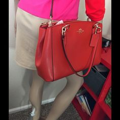 Coach Christie Carryall Carmine Inside Zip, cell phone and multifunction pockets. 2 zip closures and middle pocket. Strap23.5 for shoulder or cross body. 12x9x3 gold hardware, cross grain Leather Coach Bags Shoulder Bags
