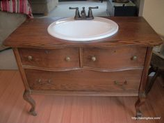 Dresser to bathroom vanity - note taps fit into 3 holes, but looks cool - revamped the drawers to work as well. Another link to finishing the top.