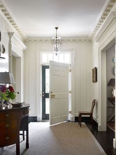 TheFullerView - gorgeous entry with dentil moulding and white walls