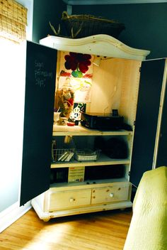 Home office ideas--used entertainment armoires can often be found for under $100 and are just begging to be repurposed!