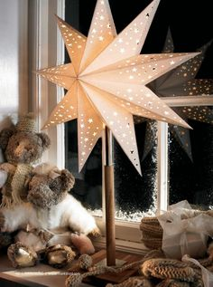 A Swedish Advent Christmas Paper Star on a white wood foot. Display on your windowsill or sideboard this Christmas to create a cosy and warm glow. Swedish Christmas Decorations, Christmas Star, Christmas Paper, Scandinavian Christmas, Christmas Wishes, Homemade Christmas, Christmas Projects, Christmas Themes, Holiday Decor