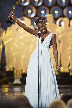 """Lupita Nyong'o accepts the Best Performance by an Actress in a Supporting Role award for """"12 Years a Slave"""" onstage during the 86th Annual Academy Awards at the Dolby Theatre in Hollywood on March 2, 2014. (Michael Yada/A.M.P.A.S.)"""
