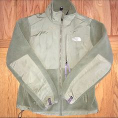 North Face Denali jacket This is a green north face fleece. The jacket is a M and in really good condition. The only things I could find have been pictured. There are a few little red marks near the chest pocket and logo and then very lightly you can see a little red on the sleeve (only if you are searching for it). Both are hard to find but just wanted to disclose! Such a fun color for the winter! North Face Jackets & Coats