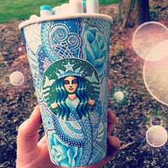 Take a plain white cup, it can be starbucks or any other cup you want and draw on it! Paper cups work best, and for my cups, I used sharpies, pen, a white gellyroll pen and copic markers.