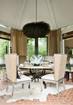 love the chairs...not too sure about that chandelier,