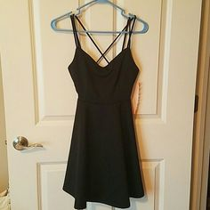 Black strappy cocktail dress Fit flare cocktail dress.  NWT. Wet Seal Dresses Mini