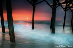 "Beach Photograph ""Sunrise at the Pier"". Blue water, red sky."