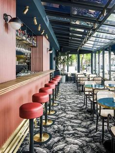 cafe waldeck amsterdam features pink and blue walls with tropical carpet | coco kelley