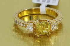 #UniqueFancyIntenseyellow #3StoneEngagementRing flanked by 2 #WhiteDiamonds  http://www.BloomingBeautyRing.com