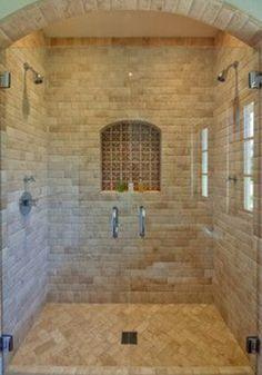 Natural stone and tile bath remodel, glass shower enclosure