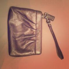 Coach wristlet Great condition. Coach wristlet- metallic pewter color Coach Bags Clutches & Wristlets