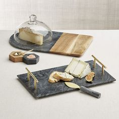 Shop Hayes Marble and Wood Serving Board with Glass Dome.  Gorgeous black marble, polished to showcase its natural color and unique veining, partners with warm acacia wood to create a stunning board for cheeses and charcuterie.
