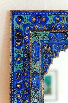 How I would love to see the entire entryway...the Islamic Calligraphy and the brilliant colors are stunning. I thought it also might be a mirror, but I can't tell.