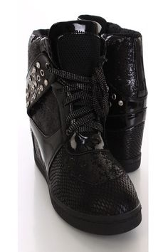Add glamour and sparkle to any outfit with these sexy sneaker wedges! They are perfect for dancing the night away or just a day out with the girls. They will look super hot paired with your favorite skinnies or dress. Make sure you add these to your closet, it definitely is a must have! It features glitter upper with metallic detail, scale textured, lace up, rhinestone decor, closed toe, stitched detailing, smooth lining, and cushioned footbed. Approximately 3 1/2 inch wedge.