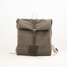 A perfect backpack for all bike riders.Rolled from the top and secured by a leather strap. $125