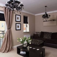 curtains for a monochromatic look Fun black crystal chandeliers give this room a little something extra. Get the look for less with this swag crystal chandelier, great if you don't have a junction box. It can be a plug-in chandelier!