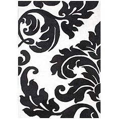 Enhance your home decor with a beautifully patterned rug. This area rug features an off-white body with a black damask pattern that is both classic and modern. This contemporary rug is constructed of wool for a plush feel.