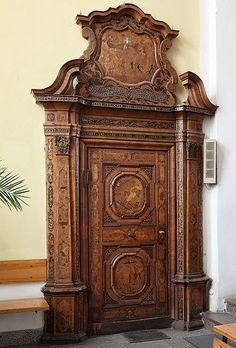 Carved and inlaid wooden portal (Holy Ghost church in Torun, Poland)