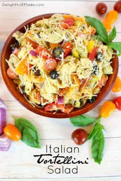 The perfect pasta salad or side dish for any pot-luck, picnic, cookout or backyard barbecue! This delicious tortellini salad is loaded with all of your Italian favorites, like salami, tomatoes, olives, banana peppers, red onion, and topped with Italian dressing and shredded Parmesan cheese!