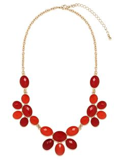 $26 This gorgeous necklace flaunts the feminine side of the posh and extravagant motif. To wit: Those bold faceted gems, in bright scarlet and deep coral, come in a lovely floral-like pattern.